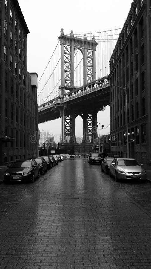 View from Dumbo. The Manahattan Bridge on a rainy day in Dumbo Brooklyn royalty free stock image