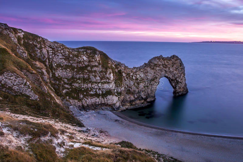 View of Durdle Door in United Kingdom at Sunset. royalty free stock photos