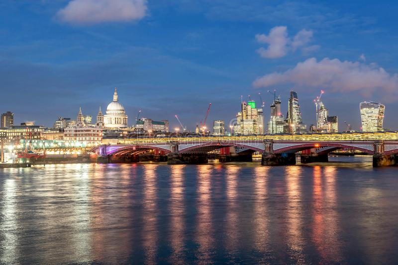 A view at dusk across the River Thames of financial skyscrapers. Of London,UK royalty free stock image
