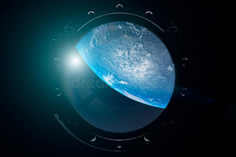 A view of the Earth from through the porthole of a spaceship. International space station is orbiting the Earth. 3D illustration.  stock photo