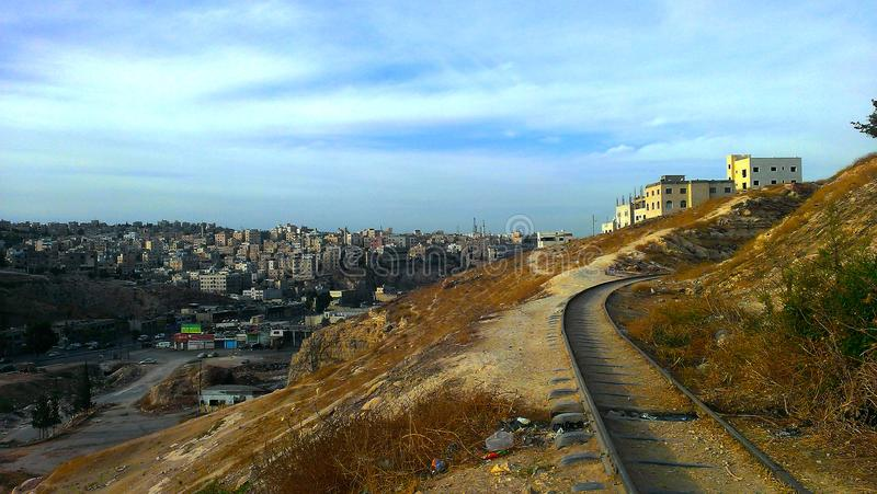 View from east Amman, Jordan. View from one of the areas east of Amman, Jordan to the archaeological railway, which is more than 100 years old stock photo