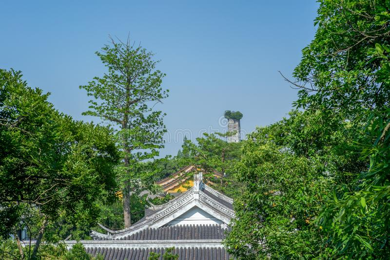View of the East Pagoda on the Jiangxin island in Wenzhou in China over the roof of the temples and trees - 1. View of the East Pagoda on the Jiangxin island in stock photos