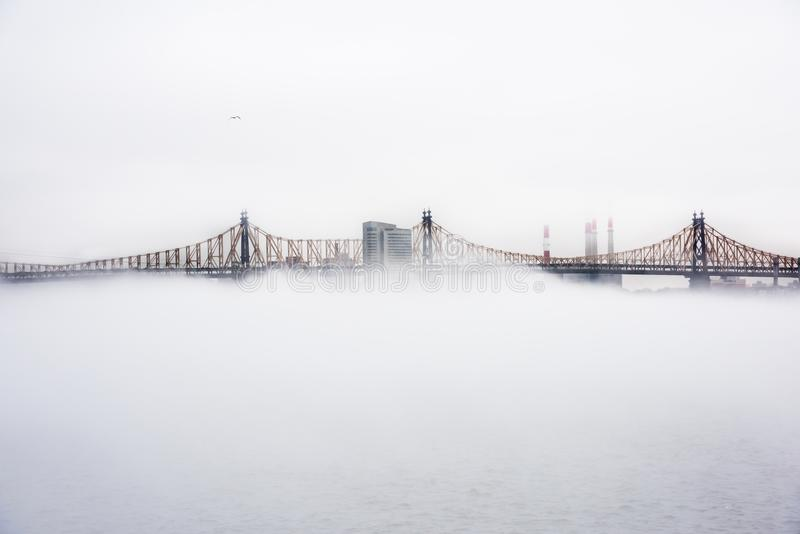 View of Ed Koch Queensboro Bridge during a fog day royalty free stock photography