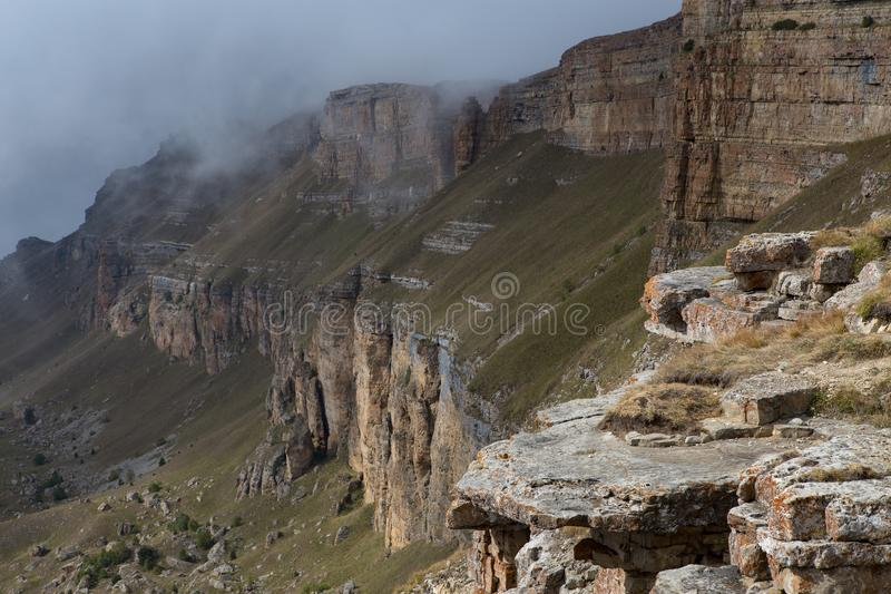 The view from the edge of the mountain plateau and the clouds in the valley. stock image