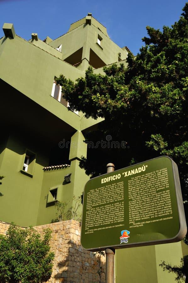 View of Edificio de Ricardo Bofill - Xanadu. Famous architectural monument - Edificio de Ricardo Bofill - Xanadu - hidden behind the trees with a Sign royalty free stock photos