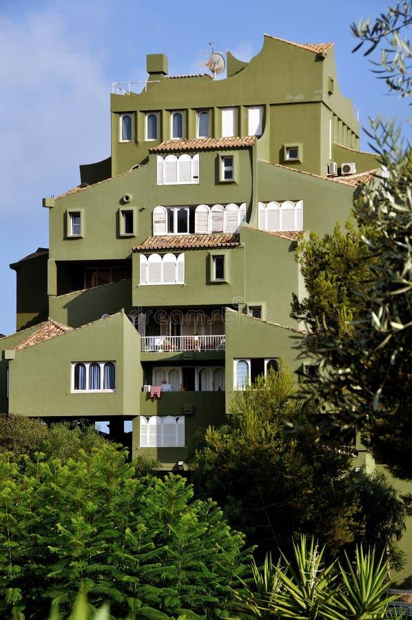 View of Edificio de Ricardo Bofill - Xanadu. Famous architectural monument - Edificio de Ricardo Bofill - Xanadu - hidden behind the trees royalty free stock photography