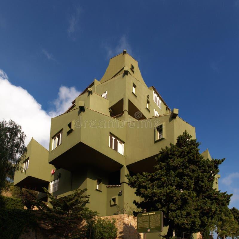 View of Edificio de Ricardo Bofill - Xanadu. Famous architectural monument - Edificio de Ricardo Bofill - Xanadu - hidden behind the trees royalty free stock image