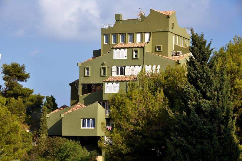 View of Edificio de Ricardo Bofill - Xanadu. Famous architectural monument - Edificio de Ricardo Bofill - Xanadu - hidden behind the trees royalty free stock photos
