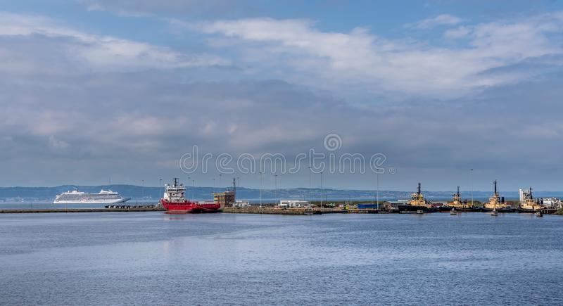 A view of Edinbrugh dock with various ships and a cruise ship stock photo