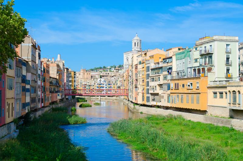 View of Eiffel Bridge Puente Eiffel, Pont de les Peixateries Velles over River Onyar, Cathedral and buildings of Girona, Spain royalty free stock image