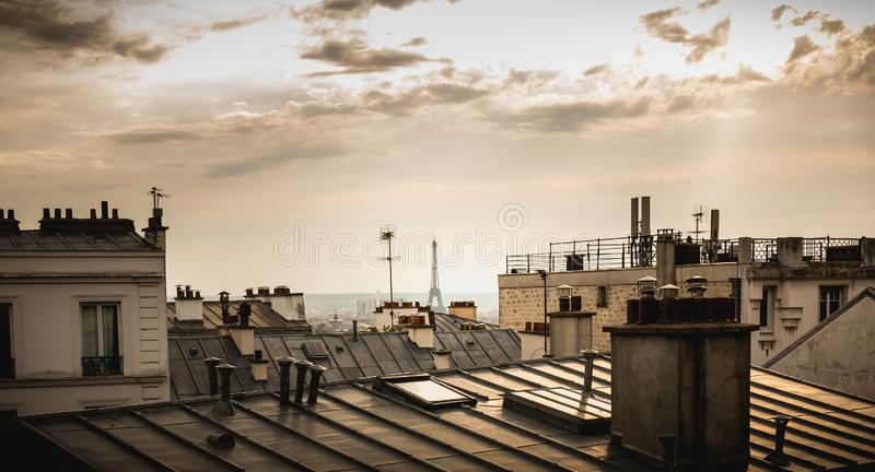 View of the Eiffel Tower above the rooftops of Paris royalty free stock image
