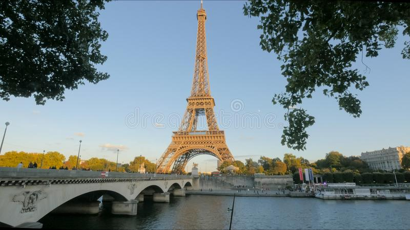View of the eiffel tower and a bridge over the river seine, paris stock image