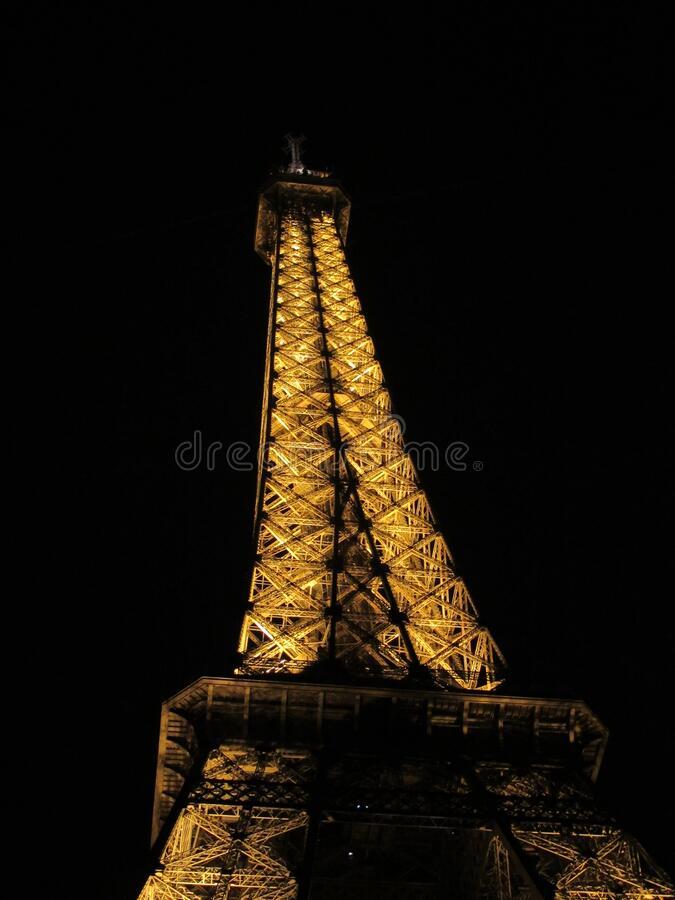Eiffel Tower in Paris, France at night. View of the Eiffel Tower in Paris, France at night with lights illuminating the structure royalty free stock images