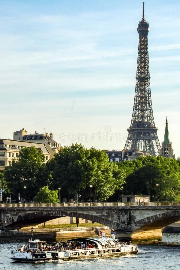 View on Eiffel Tower, Pont de la Concorde and cruise ship on Seine river in Paris in France stock image