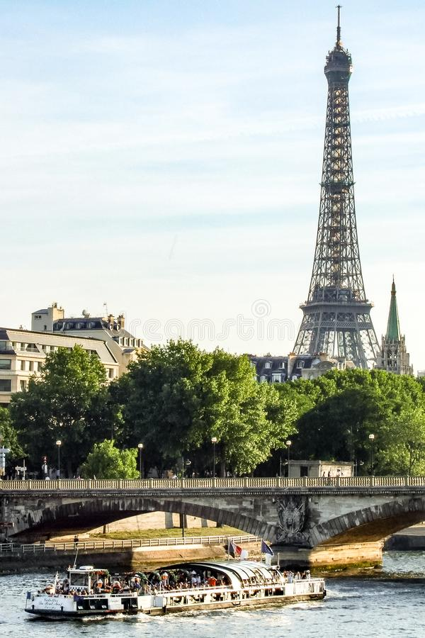 View on Eiffel Tower, Pont de la Concorde and cruise ship on Seine river in Paris in France stock photos