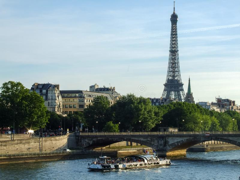 View on Eiffel Tower, Pont de la Concorde and cruise ship on Seine river in Paris in France royalty free stock images