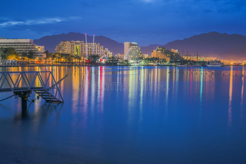 View on Eilat in the night. Evening view on resort hotels and decorative illuminations on the northern beach of Eilat city, Israel royalty free stock image