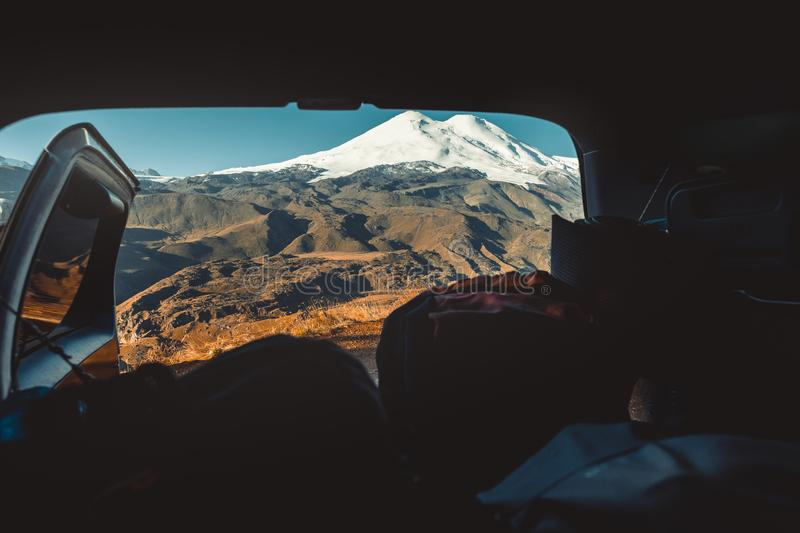 View Of Elbrus From The Rear Door Of The Car. Road Adventure Con stock photos