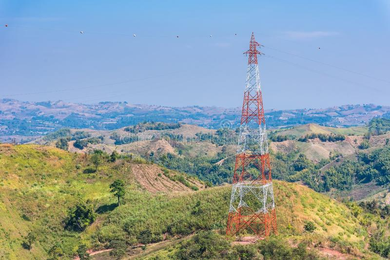 View of electricity pylon against a clear blue sky royalty free stock image