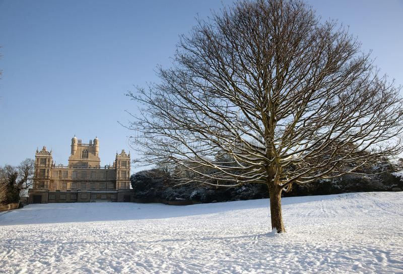 A view of the Elizabethan Wollaton Hall museum and gardens in the snow in winter in Nottingham, Nottinghamshire taken 3rd December royalty free stock images