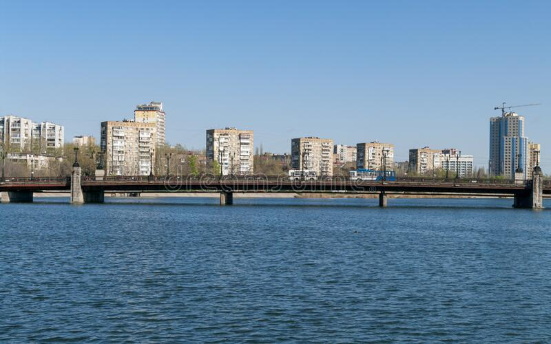 View of the embankment of the Kalmius river and bridge over it in Donetsk. Ukraine. DPR.  stock photography