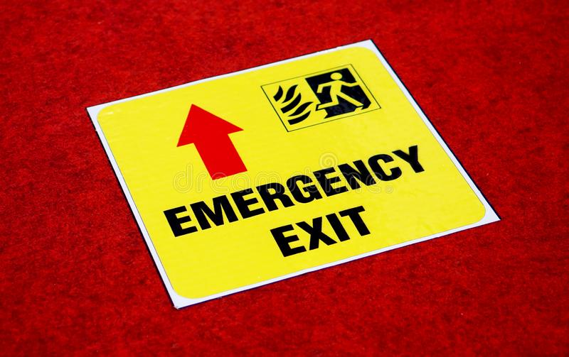 View of Emergency exit way sign sticker on the floor in a public place stock photos