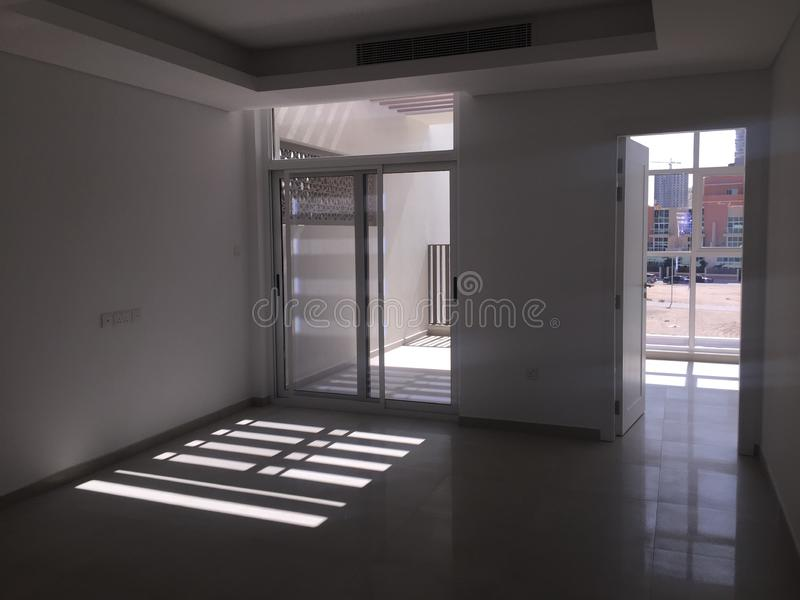 View of empty bedroom and balcony with sunlight coming inside. Brand New Real Estate stock photos