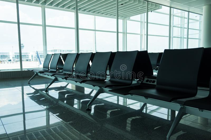 View of an empty chairs in an airport stock photo