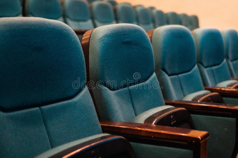 View of an empty concert hall with blue seats. Parterre. Hall. Chairs. Auditorium. Rows of chairs in the stalls of the theater royalty free stock photos
