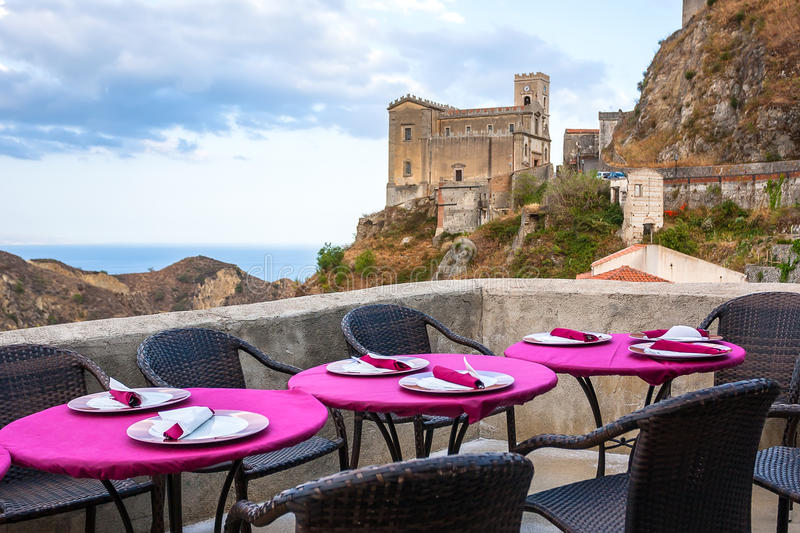 View of empty outdoor cafe in Sicily, Italy. Focus on the table royalty free stock photography