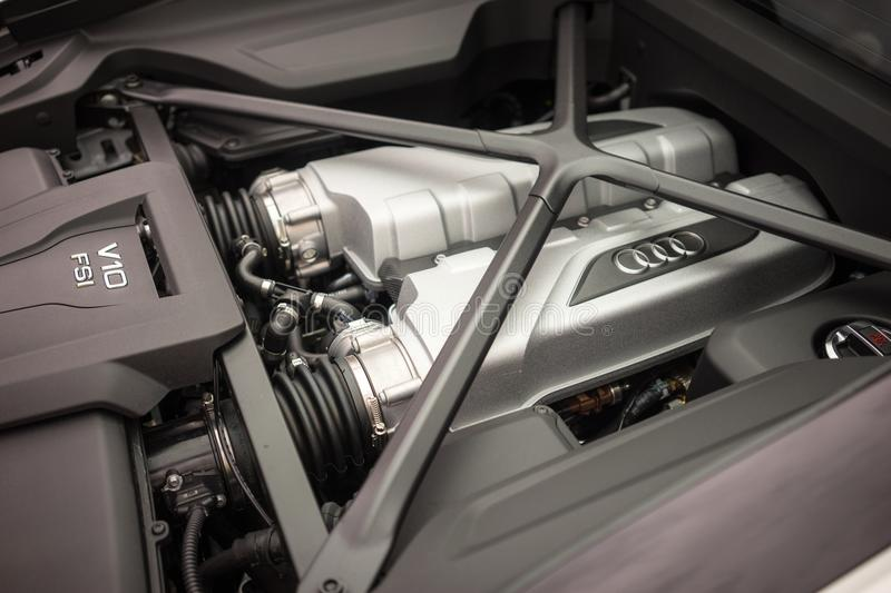 Audi Sports Car Engine. A view of the engine of an Audi sports car. Audi AG is a German automobile manufacturer that designs, engineers, produces, markets and stock photos