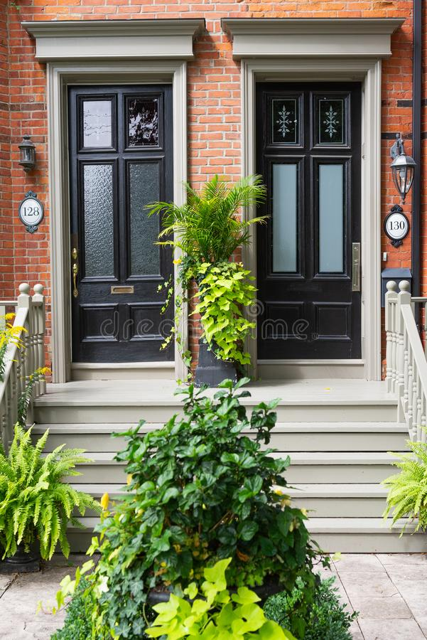 Door at old house. View at English style door into old  house, apartment, architecture, background, brick, building, detail, doorway, elegant, entrance, entryway royalty free stock photography