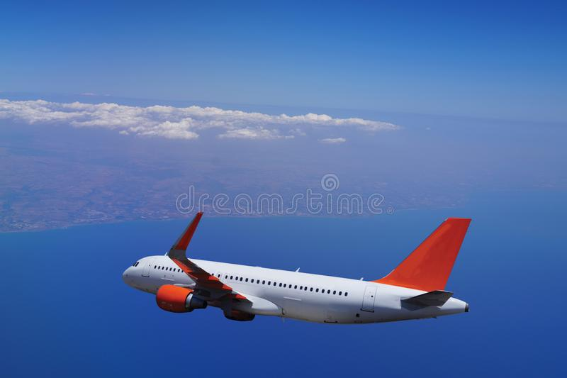 Passenger plane flies over the sea, all silhouette stock image