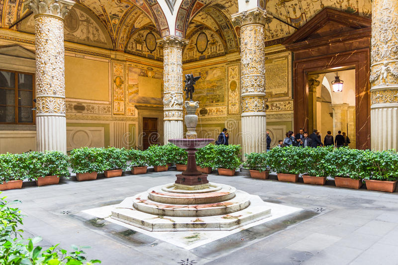 View of the entrance courtyard of the Palazzo Vecchi, Florence. View of the entrance courtyard of the Palazzo Vecchio. The colums are decorated with gilt stock photos