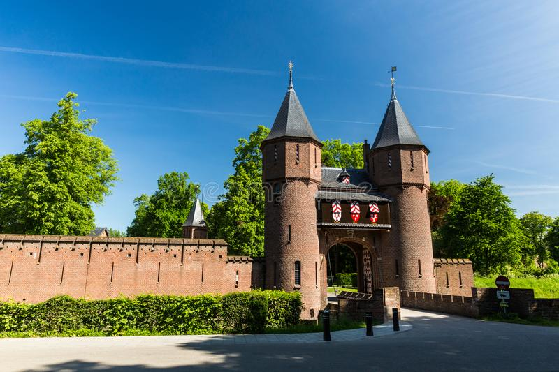 View of the entrance gate of the Kasteel de Haar Castle. KASTEEL DE HAAR, NETHERLANDS - MAY 28, 2017: View of the entrance gate of the Kasteel de Haar Castle on royalty free stock photo