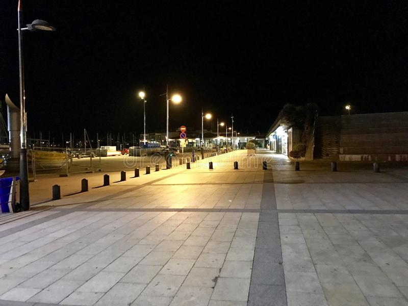 View of the entrance to the marina zone in Sanxenxo, Galicia, Spain during night. royalty free stock photos