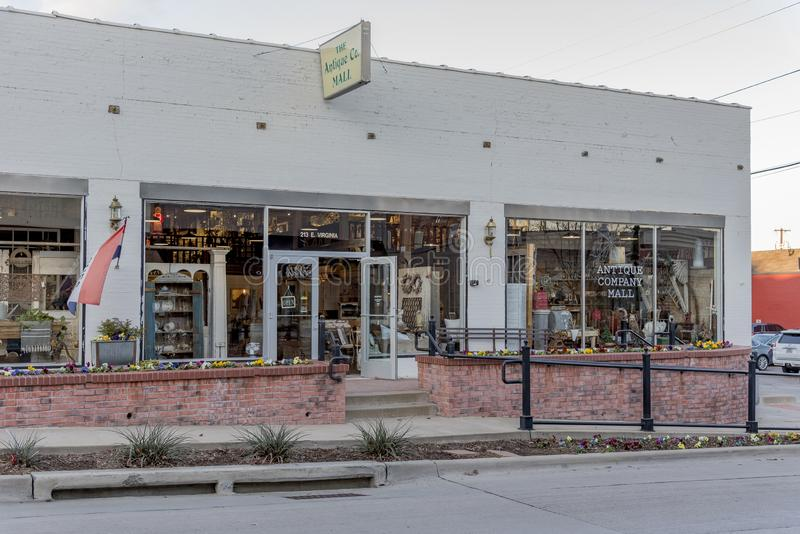 View of the entrance and the windows of an antique shop captured in McKinney, Texas, United States. MCKINNEY, UNITED STATES - Dec 28, 2018: A view of the royalty free stock image