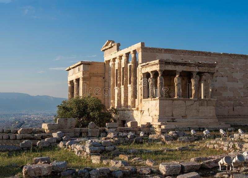 View of Erechtheion and porch of Caryatids on Acropolis, Athens, Greece, against sunset. View of Erechtheion and porch of Caryatids on Acropolis in Athens royalty free stock photos