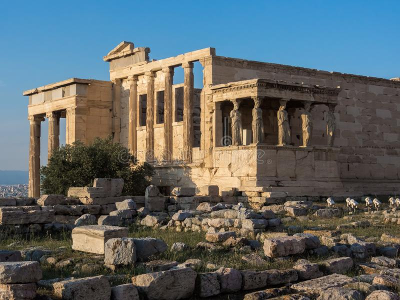 View of Erechtheion and porch of Caryatids on Acropolis, Athens, Greece, against sunset. View of Erechtheion and porch of Caryatids on Acropolis in Athens royalty free stock photography