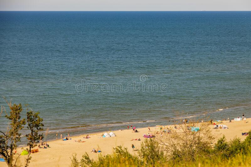 View from the escarpment to the beach on the Baltic Sea on a summer day with people stock photo