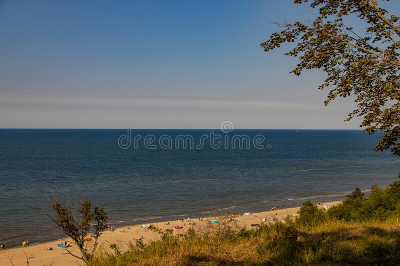 View from the escarpment to the beach on the Baltic Sea on a summer day with people stock photos