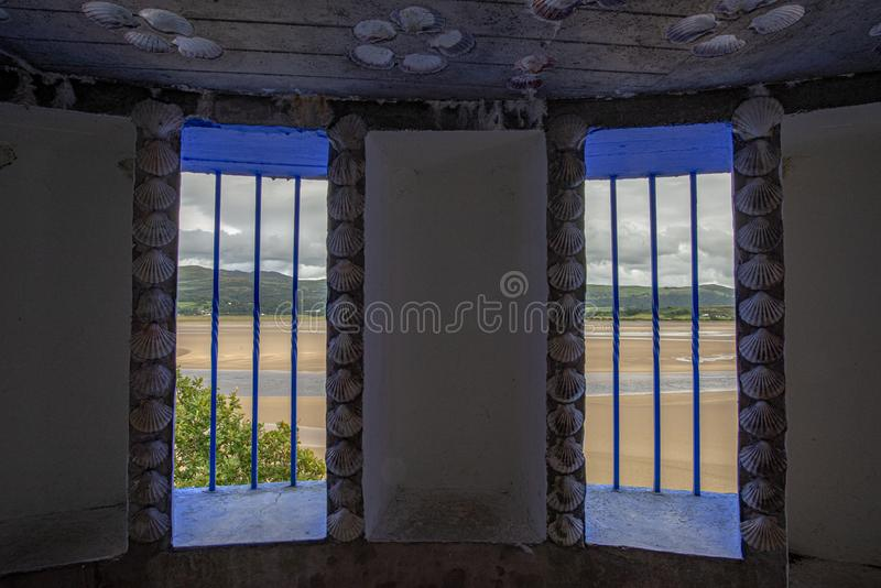View on an estuary from blue fringed windows of a Portmeirion grotto stock photos
