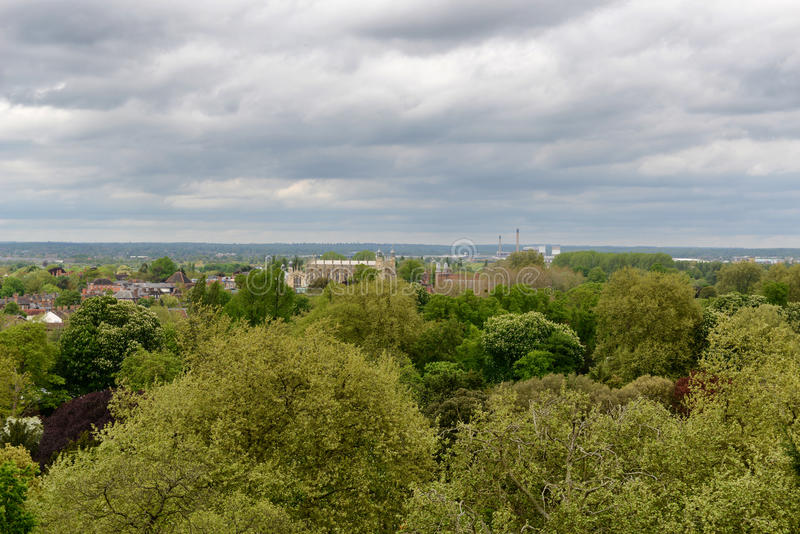 View of Eton from Windsor castle. View of the town and college at Eton from Windsor Castle over woodland and parkland on a cloudy day, Berkshire, UK royalty free stock images