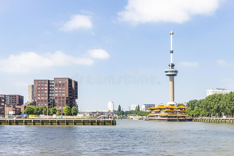 View of the Euromast in Rotterdam with there beside the boat of Hotel Restaurant New Ocean Paradise stock image