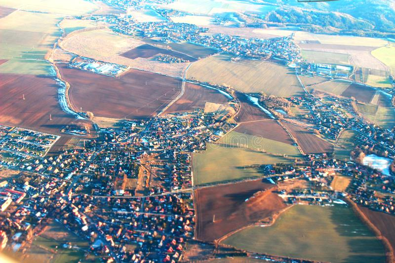 View of European villages from airplane. Flying through villages and cities in Europe stock photos