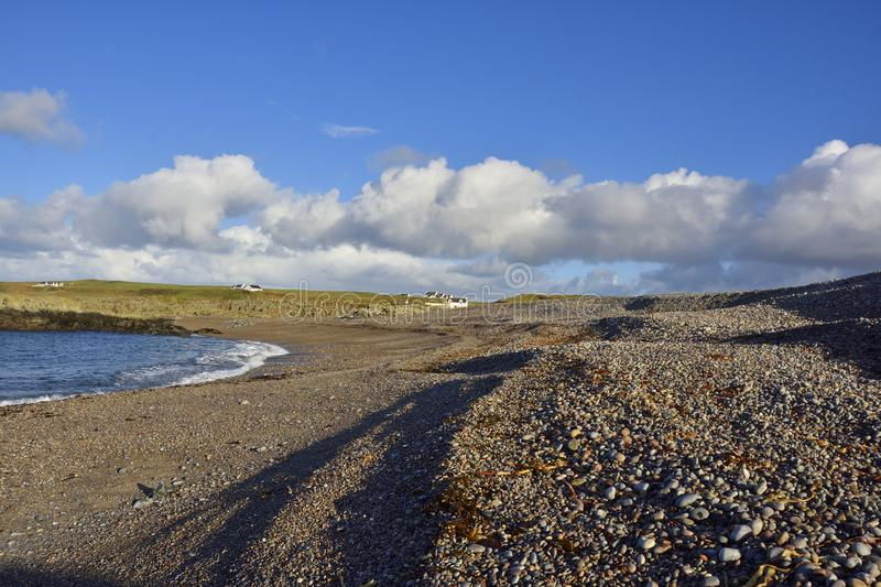 Scottish Island Shingle Beach. View of the expansive shingle beach near Portnahaven, island of Islay, Scotland, a site of special scientific interest royalty free stock photos
