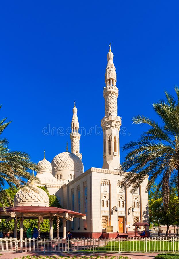 View of the facade of the building of the mosque Jumeirah. Isolated on blue background, Dubai, United Arab Emirates. Vertical stock photography