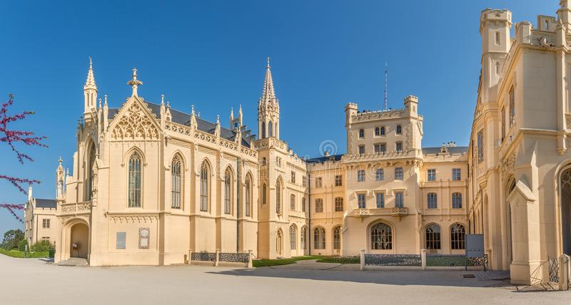 View at the facade of Lednice castle and St.Jakub chapel - Czech republic,Moravia. View at the facade of Lednice castle and St.Jakub chapel - Czech republic royalty free stock photos