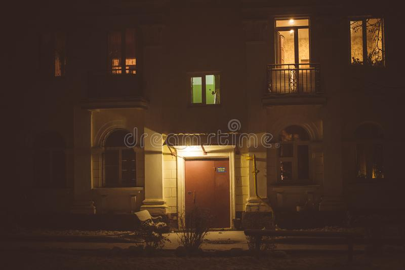 View of the facade of a residential apartment building in the evening, the light in the windows. Obninsk, Russia royalty free stock photography