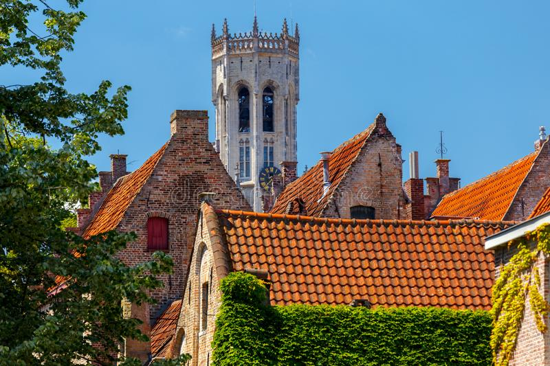 Brugge. The Tower Belfort. View of the facades of old houses and tower Belfort. Brugge. Belgium stock photography